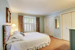 Soft tones bedroom interior in old house Stock Photos