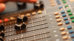 Audio recording professional adjusts large mixing board in recording studio 6 Stock Footage