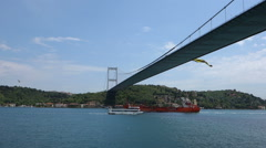 Ships passing under the Fatih Sultan Mehmet Bridge in Istanbul Stock Footage