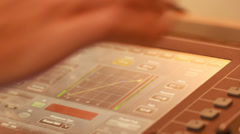 Audio recording professional adjusts large mixing board in recording studio 9 Stock Footage