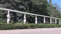 Stock Video Footage of Nice statue, national park entry, Bucharest historical landmark trees background