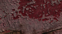 Pan of old flaking paint on hull of boat Stock Footage