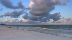 Surf along Clearwater beach at sunrise. Stock Footage