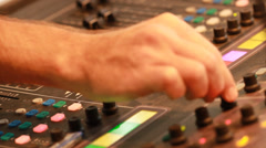 Audio recording professional adjusts large mixing board in recording studio 10 Stock Footage