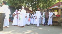 The Locals passing near the Temple of the Tooth in Kandy. Stock Footage