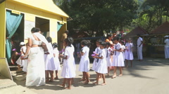 Locals and school kids entering the Temple of the Tooth in Kandy. Stock Footage