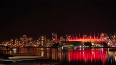 4K Time Lapse - Long exposure cityscape and water taxis at night Vancouver - stock footage