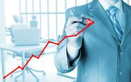 Stock Illustration of Business man drawing a growing graph