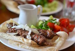 georgian cuisine - kebab in pita bread. - stock photo