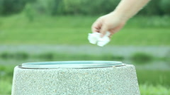 Man hand throwing out piece of paper in trash can Stock Footage
