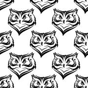 seamless pattern of the head of a fierce owl - stock illustration