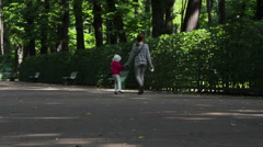 Mother and daughter in the park. St. Petersburg. Russia. Stock Footage