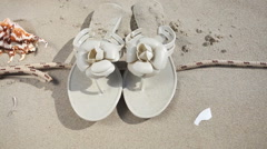 Female flip-flops on the beach. Full HD with motorized slider. 1080p. Stock Footage
