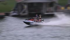 Wave runner couple on lake 3 Stock Footage