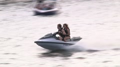 Wave runner couple on lake Stock Footage