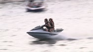 Stock Video Footage of Wave runner couple on lake