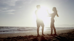 Silhouette Romantic Couple Love Dancing Beach Man Woman Honeymoon Slow Motion 4K Stock Footage