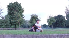 Man playing with dog Stock Footage