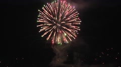 fireworks large shell starburst explosions in sky and lake reflection - stock footage