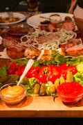 Table in the restaurant. vegetables and meat Stock Photos