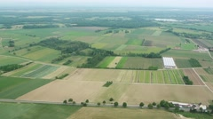 France, aerial view over houses, agricultural fields and highway in the  country Stock Footage