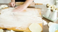 Cooking and home concept - close up of female working with rolling-pin Stock Footage