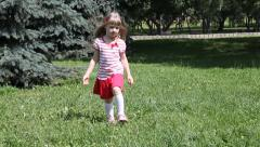 Pretty little girl playing on a summer meadow Stock Footage