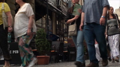 Crowded Street, People Walking By, East Europe, Bucharest, Crowds, Low Angle Pan - stock footage