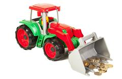 red and green bulldozer with coins - stock photo