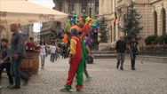 Stock Video Footage of Clown Selling Balloons In A Busy Street, Crowded, People, Fun