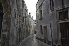 old alley  in lecce - stock photo