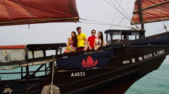 Multi Ethnic Tourists Sailing Chinese Junk Stock Footage