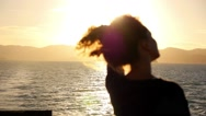 Stock Video Footage of Woman Playing with Her Curly Hair and Admiring Magic Sunrise.