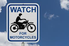 Watch for motorcycles warning sign Stock Photos