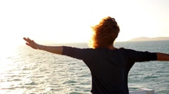 Girl Spreading Hands with Joy and Inspiration Facing the Sun. Spectacular Stock Footage