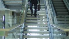 Businessman is Moving Down the Stairs Towards the Camera in Office Building Stock Footage