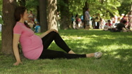 Stock Video Footage of 9 months pregnant young woman in the park
