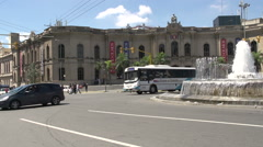 Stock Video Footage of Cars driving around the Water Fountain dancers called 'Forgiveness' in Cordoba