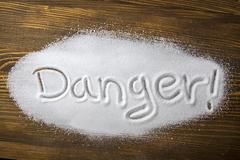 danger of too much salt – health hazard - stock photo