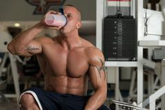 bodybuilder with protein shaker - stock photo