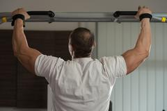 Male athlete doing pull ups Stock Photos