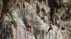 Athletes climbing, Ao Nang Krabi, Thailand. Stock Footage