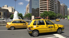 Pan of a taxi driving away in Cordoba Argentina Stock Footage