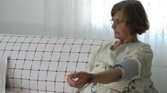Old Woman and Sphygmomanometer Stock Footage