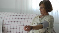 Stock Video Footage of Old Woman and Sphygmomanometer