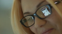 Reflection of a Screen of Tablet in Glasses Stock Footage