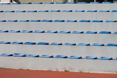 Plastic blue seats on football stadium Kuvituskuvat
