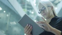 Pretty Businesswoman Using Tablet PC in Office Building Stock Footage