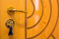 Keys is inserted into a keyhole Stock Photos