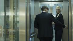 Businessman and Woman are Getting on the Elevator Stock Footage